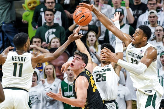 Xavier Tillman put on a defensive against Iowa's Luka Garza (center), Maryland's Jalen Smith, Penn State's Lamar Stevens and Ohio State's Kaleb Wesson during the last two weeks of MSU's season.