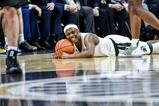 Michigan State's Cassius Winston smiles after Aaron Henry was fouled during the second half on Tuesday, Feb. 25, 2020, at the  Breslin Center in East Lansing.