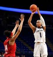Penn State's Alisia Smith (1) takes a shot over Wisconsin's Imani Lewis (34) during first half action of an NCAA college basketball game, Thursday, Jan. 3, 2019, in University Park, Pa. (AP Photo/Chris Knight)