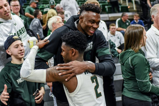 Michigan State's Rocket Watts, below, hugs basketball commit Mady Sissoko after the game on Tuesday, Feb. 25, 2020, at the  Breslin Center in East Lansing. The Spartans beat Iowa 78-70.