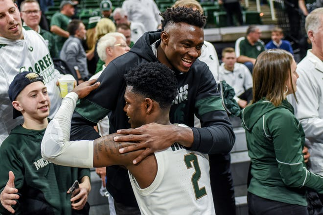 Rocket Watts hugs then-MSU-recruit Mady Sissoko after a game last season. Watts' performance at point guard and the addition of Sissoko in the paint are two intriguing elements to this year's MSU team.