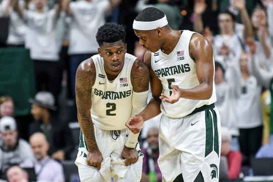 Michigan State's Cassius Winston, right, talks with Rocket Watts during the second half on Tuesday, Feb. 25, 2020, at the  Breslin Center in East Lansing.