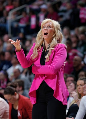 Michigan State coach Suzy Merchant reacts during the first half of an NCAA college basketball game against Michigan, Sunday, Feb. 23, 2020, in East Lansing, Mich. Michigan won 65-57. (AP Photo/Al Goldis)