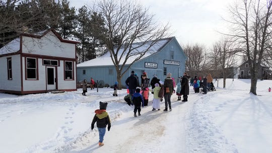 Guests enjoy the Pinecrest Historical Museum in Manitowoc in winter with site strolls.