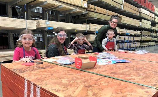 Kids participate in a kids build event at Lowe's in Manitowoc.