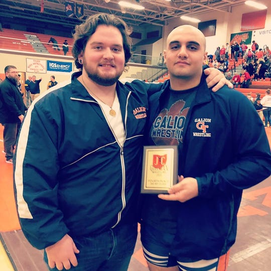 """Galion heavyweight John Abouhassan, after finishing fourth in this year's J.C. Gorman Invitational, with his """"big brother"""" Deaken McCoy, a state runner-up heavyweight for the Tigers in 2015"""
