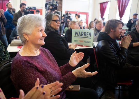 Supporters applaud during a campaign rally for Elizabeth Warren at Makeda's Butter Cookies on Wednesday, February 26, 2020.