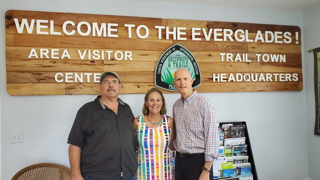 Senator Rick Scott, right, with Mayor Howie Grimm and Kathy Brock on Feb. 21 in new Everglades Area Visitor Center.