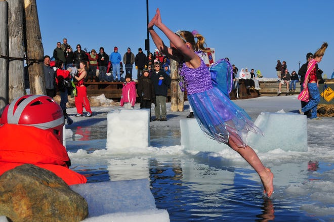 A polar plunger jumps into Lake Superior during the Bayfield Winter Festival.