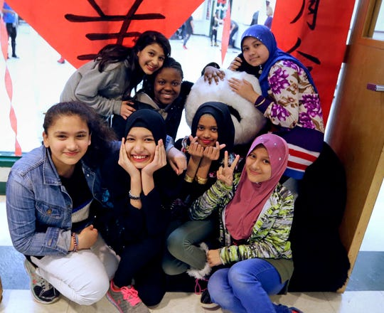 Students at Milwaukee Public Schools' International Newcomer Center pose for a group photo before a Chinese lanterns program at the Milwaukee Academy of Chinese Language. The Newcomer Center, housed inside MACL, is designed to kick-start language acquisition and subject matter content for mostly refugee students.