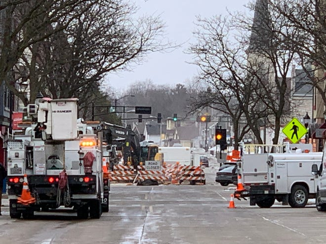Utility trucks from We Energies converge on the scene of a major gas leak on Main Street in downtown Waukesha, at or near the Barstow Street construction project area, on Wednesday morning, Feb. 26. Waukesha police blocked off all approaches to the site of the leak as a safety precaution.