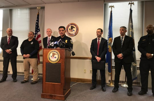 Milwaukee-area law enforcement officials flank Milwaukee Police Chief Alfonso Morales as he discusses the federal charges filed against two dozen alleged members of a violent drug trafficking gang in Milwaukee known as the Buffum Meinecke Boys.