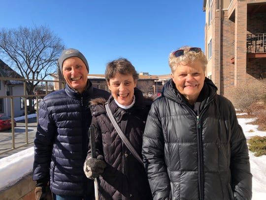 Mary Callen (middle) said friends like Kristine Hinrichs (right) and John Rodee have helped her stay active after her husband died in 2018.
