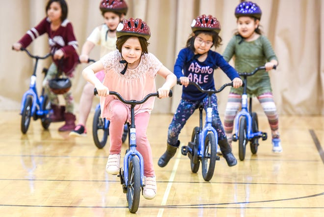 Kindergartners in the All Kids Bike Program learn to ride bikes in their physical education classes.