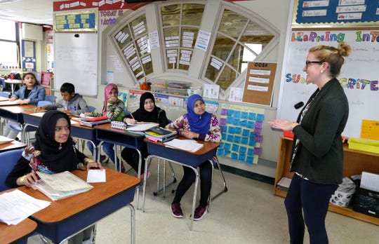 Teacher Erin Sivek, who is certified in English as a second language as well as language arts, works with students at Milwaukee Public Schools' International Newcomer Center. The program marries ESL with subject matter content to help kick-start the language acquisition and academic progress of the mostly refugee students who attend.