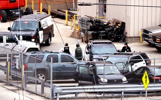 Milwaukee police, county sheriff and fire department personnel respond to a fatal mass shooting at Molson Coors on Wednesday, Feb. 26, 2020.