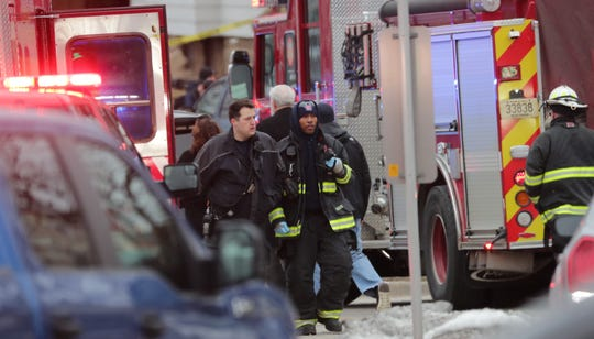 Emergency workers gather near the corner of North 35th and West State streets Wednesday where there was a fatal shooting at nearby Molson Coors.