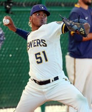 Milwaukee Brewers Freddy Peralta throws in the bullpen during spring training drills.