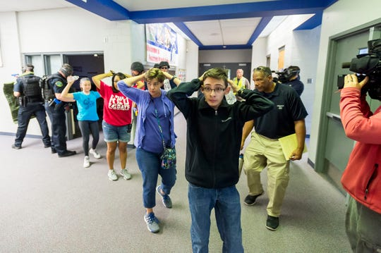 Students are led out of school as members of the Fountain (Colo.) Police Department take part in an active shooter response training exercise at Fountain Middle School in Fountain, Colo. The nation's two largest teachers unions want schools to revise or eliminate active shooter drills, asserting that they can harm students' mental health and that there are better ways to prepare for the possibility of a school shooting.