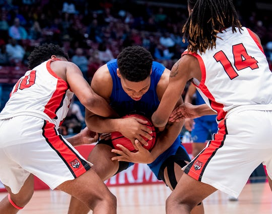 Montgomery Catholic's TJ Dudley (11) is double teamed by Talladega's Arron Green (10) and Rontavious Barclay (14) during the AHSAA Finals at Legacy Arena in Birmingham, Ala., on Tuesday February 25, 2020.