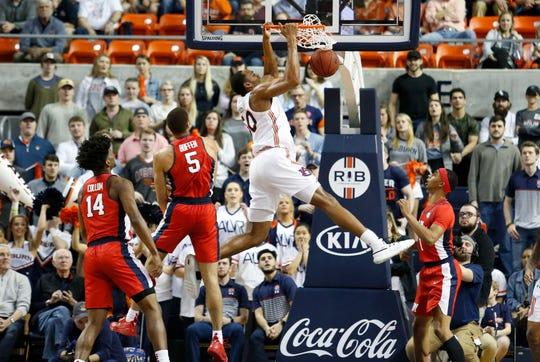 Auburn center Austin Wiley (50) makes a dunk against Ole Miss on Feb. 25, 2020.