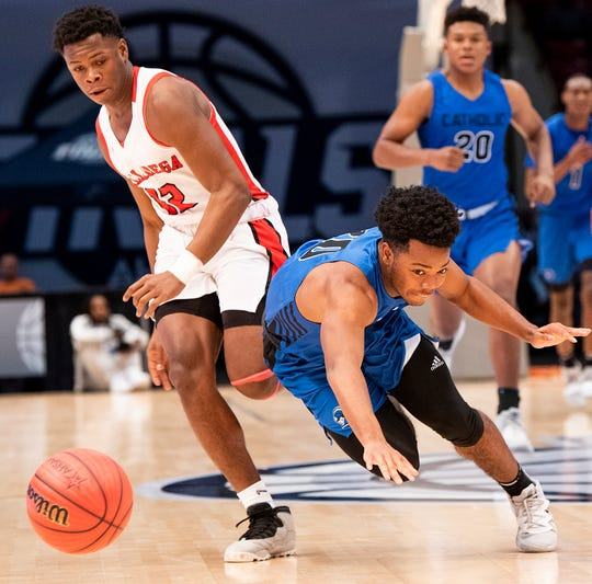 Montgomery Catholic's Jalen Thomas (10) and Talladega's Michael McGregor (12) go after a loose ball during the AHSAA Finals at Legacy Arena in Birmingham, Ala., on Tuesday February 25, 2020.