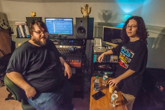 Chris Lantrip and Andie Schultz in Headless Dinosaur Recording's control room, which is upstairs in their Montgomery home.