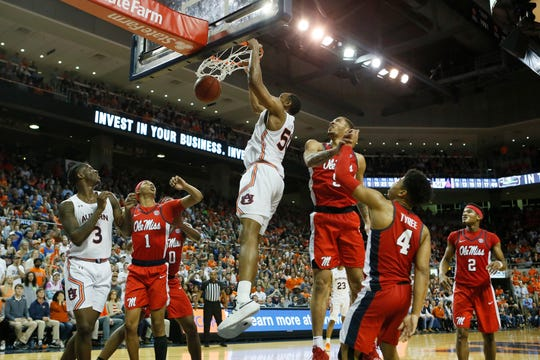 Feb 25, 2020; Auburn, Alabama, USA;  Auburn Tigers center Austin Wiley (50) dunks the ball against the Ole Miss Rebels during the second half at Auburn Arena. Mandatory Credit: John Reed-USA TODAY Sports