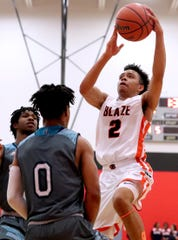 Blackman's guard Ray Tyler (2) shoots the ball as Siegel's Zion Swader (0) guards him at Stewarts Creek on Tuesday, Feb. 25, 2020, during the 7-AAA District Tournament championship game.