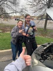 Chick-fil-A employee Sarah Hood, right, poses with Izzy Burton, whose friend, Emma McClung, who is giving a 'thumbs up' in the photo. Hood helped McClung open a bottle of engine oil for her 2012 Chevy Cruze, which broke down in the parking lot of the Old Fort Parkway Chick-fil-A in Murfreesboro on Monday, Feb. 25, 2020.