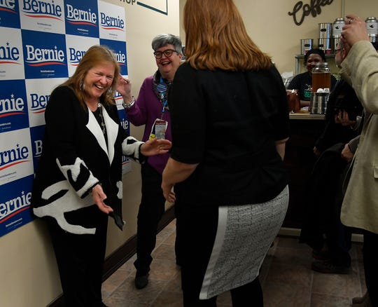 Jane Sanders (lt) laughs with supporters as she makes a campaign visit to The Bean Bag Coffee and Tea Shop for her husband Bernie Sanders Wednesday, Feb. 26, 2020 in Nashville, Tenn.