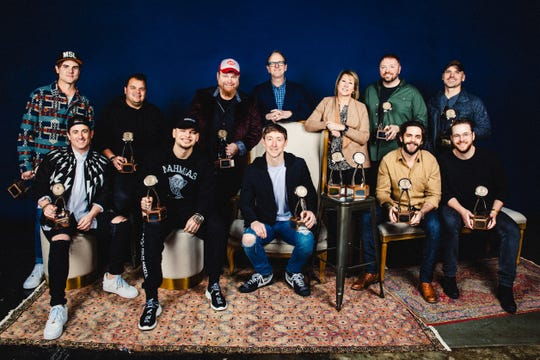 The 11th annual CMA Triple Play Awards recipients were honored at an industry luncheon Feb. 25, 2020, at Marathon Music Works in Nashville. Back row from left: Ross Copperman, Justin Ebach, Bobby Pinson, Jim Beavers (host), Sarah Trahern (CMA chief executive officer), Josh Osborne and Jon Nite. Front row from left: Jesse Frasure, Kane Brown, Ashley Gorley, Thomas Rhett and Jordan Reynolds.