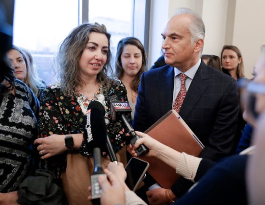 RaDonda Vaught answers questions with her attorney, Peter Strianse, right, after a court hearing Wednesday, Feb. 20, 2019, in Nashville, Tenn. Vaught, a former nurse at Vanderbilt University Medical Center, is charged with reckless homicide after a medication error killed a patient. (AP Photo/Mark Humphrey)