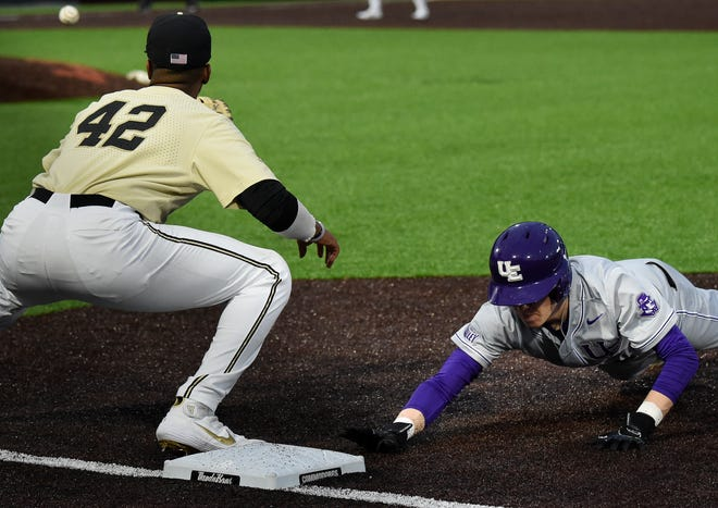 Evansville catcher Max Malley (8) beats the throw back to first base past Vanderbilt first baseman Justyn-Henry Malloy (42) at Hawkins Field Tuesday, Feb. 25, 2020 in Nashville, Tenn.