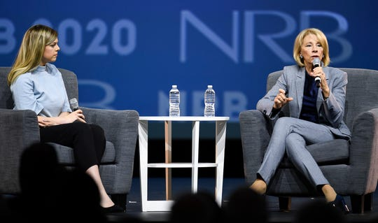 Allie Stuckey interviews U.S. Secretary of Education Betsy DeVos during the NRB 2020 Christian Media Convention at the Gaylord Orpyland Resort and Convention Center Wednesday, Feb. 26, 2020 in Nashville, Tenn.