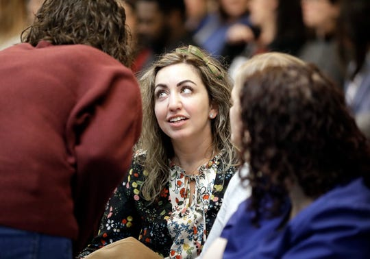 RaDonda Vaught, center, sits with supporters as she waits in court for her hearing to begin Wednesday, Feb. 20, 2019, in Nashville, Tenn. Vaught, a former nurse at Vanderbilt University Medical Center, is charged with reckless homicide after a medication error killed a patient. (AP Photo/Mark Humphrey)