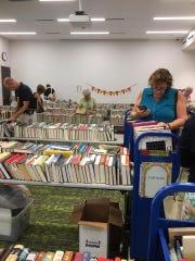 Readers browse at the Friends of the Bonita Springs Library book sale last fall at the Bonita Springs Public Library. The sale is 9 a.m.-4 p.m. Friday, Feb. 28, and Saturday, Feb. 29.
