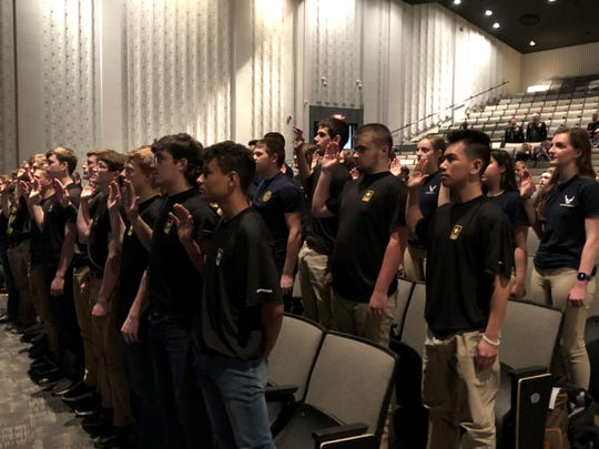 Students  from Newark High School, Licking County and other area counties take an historic Oath of Enlistment from U.S. Army Colonel and NASA Astronaut Andrew Morgan, who was aboard the International Space Station. The swearing in took place Wednesday in the Newark High School auditorium.