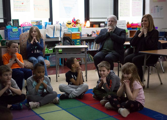 Paolo DeMaria, Ohio's Superintendent of Public Instruction and Ohio Board of Education member, Stephanie Dodd practice mindful breathing exercises with Mrs. Williams second grade class at John Clem Elementary. DeMaria was visiting Newark school Tuesday to see how they implement different techniques to help kids with mental health.