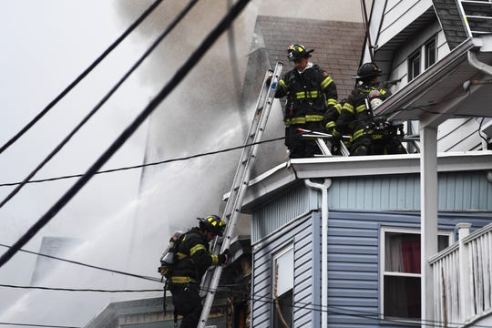 Firefighters on the scene of a fire on North 5th Street in Paterson on Wednesday, February 26, 2020.