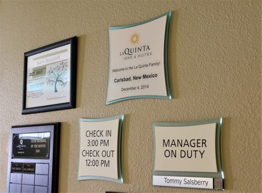 Guests at the La Quinta Inns and Suites in Carlsbad are greeted by a sign on Feb. 26, 2020 showing General Manager Tommy Salsberry is in the office.