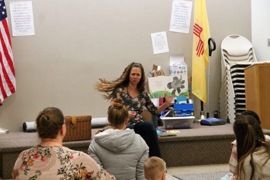 "Youth Services Librarian Ami Jones reads ""Dancing Feet!"" by Lindsey Craig at the  Alamogordo Public Library story time Wednesday morning Feb. 26, 2020. This week, story time celebrated National Dance Day."