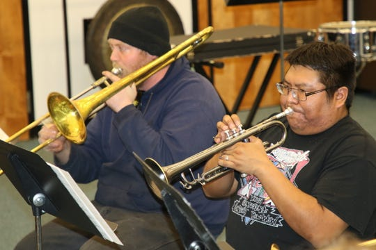 Delbert Anderson, right, was a high school trumpet player when he was spotted performing at the San Juan College Jazz Festival in the early 2000s by Chris Beaty.