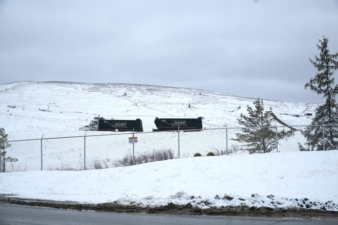 A truck ascends the Arbor Hills landfill at Six Mile and Napier in February 2020.