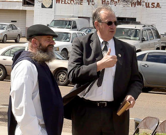 Rev. Miichael Champagne, left, and St. Landry Parish Sheriff Bobby Guidroz.