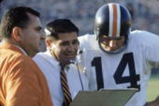 Sam Boghosian, center, is seen here as an assistant coach for Oregon State University between head coach Dee Andros and  quarterback Steve Preece in 1968. Boghosian, who coached in college and the NFL from the 1950s into the 1980s and was on the staff of two Super Bowl-winning teams with the Oakland/Los Angeles Raiders, died Sunday in Indian Wells at 88.