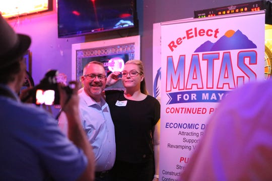 Desert Hot Springs Mayor Scott Matas and his wife Victoria Matas pose for a photo during a public event at Playoffs Sports Lounge in Desert Hot Springs, Calif., on February 25, 2020.