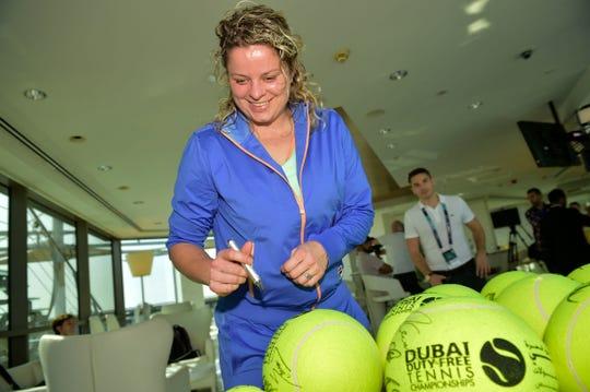 Kim Clijsters sogns tennis balls at the international media day ahead of the 2020 Dubai Tennis Championships, in Dubai, United Arab Emirates, Sunday 16 February 2020.