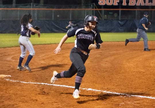 Courtney Lundquist (2) rounds third on the way home as the Aggies take a 5-0 lead during the Tate vs Escambia softball game at Escambia High School on Tuesday, Feb. 25, 2020.