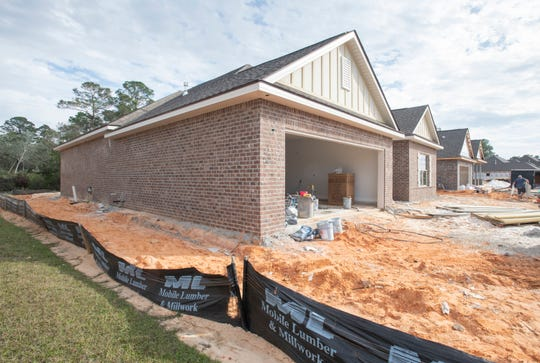 Silt fencing surrounds a house under construction in the Waters subdivision off of Soundside Drive in incorporated Gulf Breeze. Santa Rosa County has unveiled its new land development code, which includes a number of changes for new commercial and residential developments in the county.
